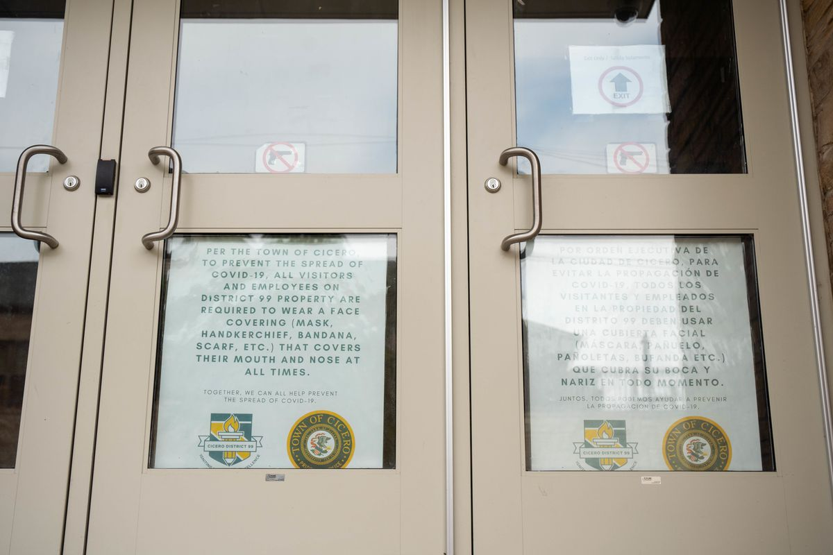 A sign that reminds people to wear face coverings is posted on the door of Theodore Roosevelt Elementary School, 1500 S. 50th Ave. in Cicero, Ill. Friday afternoon, Oct. 9, 2020.