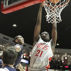 New Mexico's Tony Snell (21) dunks the ball against BYU during an NCAA college basketball game on Saturday, Jan. 29, 2011, in Albuquerque, N.M.  New Mexico won 86-77 over 9th ranked BYU.