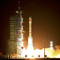 A Long March-2FT1 carrier rocket loaded with China's Tiangong-1 space station blasts off in 2011.   Color China Photo via AP file photo