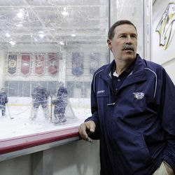 In this photo taken, April 23, 2012, Nashville Predators director of hockey operations Brent Peterson watches NHL hockey practice in Nashville, Tenn. Peterson was diagnosed in 2003 with Parkinson's disease, which forced him out of his assistant coaching position last year. Peterson turned to a procedure called deep brain stimulation where surgeons implanted probes directly into his brain with him awake.