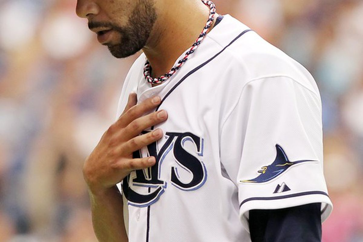 July 4, 2012; St. Petersburg, FL, USA; Tampa Bay Rays starting pitcher David Price (14) walks back to the dugout after he pitched the first inning against the New York Yankees at Tropicana Field. Mandatory Credit: Kim Klement-US PRESSWIRE