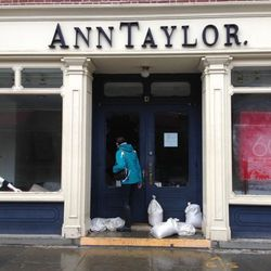 """Also from Lock: """"Smashed front window at Ann Taylor store. Wasn't much looting, though, as tons of merch remains strewn inside. A total mess."""""""