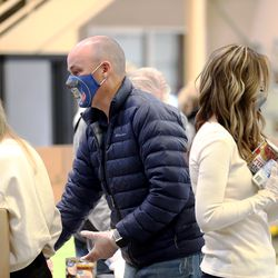 Gov.-elect Spencer Cox and his wife, Abby, sort food as they and Lt. Gov.-elect Deidre Henderson and members of their families volunteer at the Utah Food Bank in St. George on Saturday, Jan. 2, 2021.