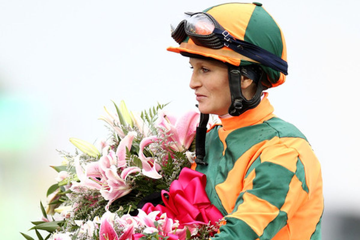 Rosie Napravnik celebrates her win in the Kentucky Oaks. She is the first female jockey to win the race in the history of its running.