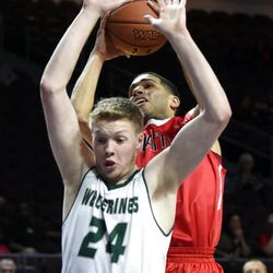 Utah Valley's Jared Stutzman (24) looks to block a shot by Seattle's Brendan Westendorf during the first half of an NCAA college basketball game in the first round of the Western Athletic Conference tournament Thursday, March 9, 2017, in Las Vegas. (AP Photo/David Becker)