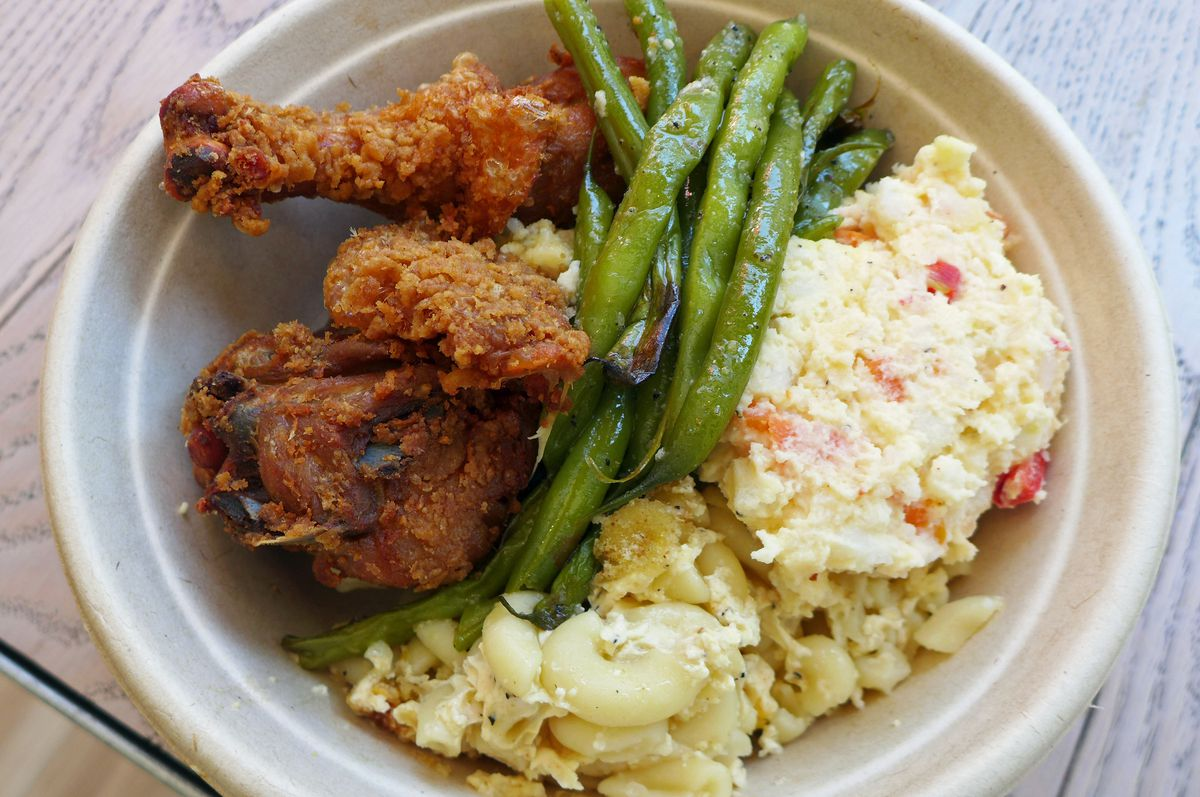 A typical $10 feed at Carmen's Kitchen might include fried chicken and three sides.