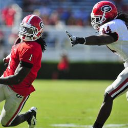 Isaiah Crowell, left, runs past T.J. Stripling during the second half of G-Day, the University of Georgia NCAA college spring football game in Athens, Ga., Saturday, April 14, 2012. The Red Team won 32-31.