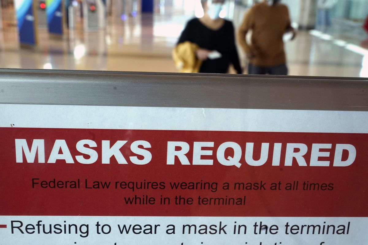 To prevent the spread of Covid-19, a sign directs travelers to wear masks at Love Field Tuesday, March 2, 2021, in Dallas.