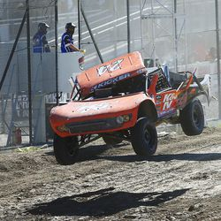 Bradley Morris in the K&N 24 truck has his cab cover come off during racing as he competes in the Pro 2 division in the Lucas Off-Road races in Tooele on Saturday, June 24, 2017.