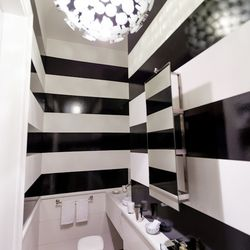 """The powder room on the main level was designed by Barbara Chambers of <a href=""""http://www.chambersandchambers.com/"""">Chambers + Chambers</a>.  [Photo by <a href=""""http://www.patriciachangphotography.com/"""">Patricia Chang</a>]"""