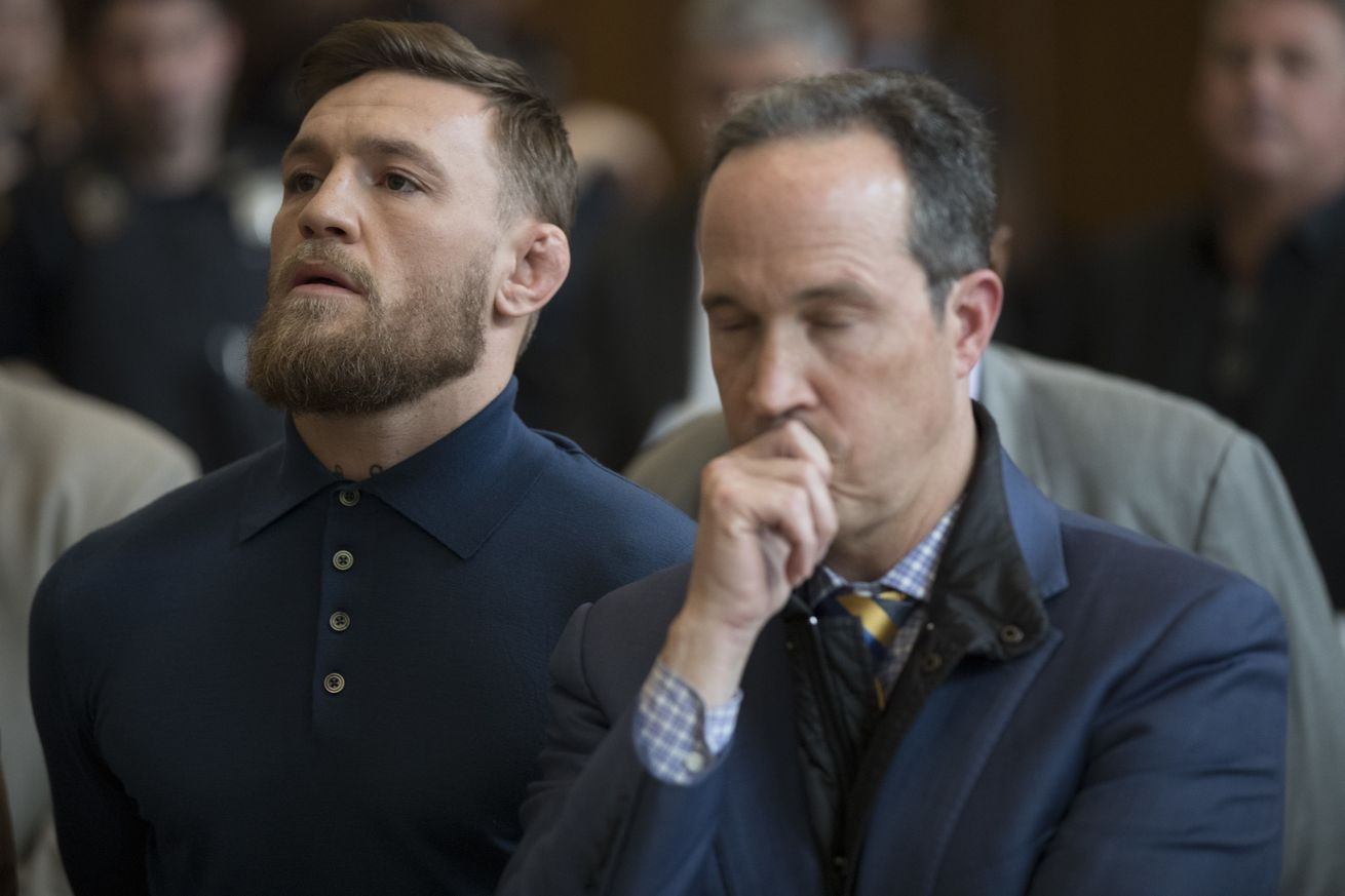 Conor McGregor stands with his lawyer Jim Walden during an arraignment in Brooklyn Criminal court