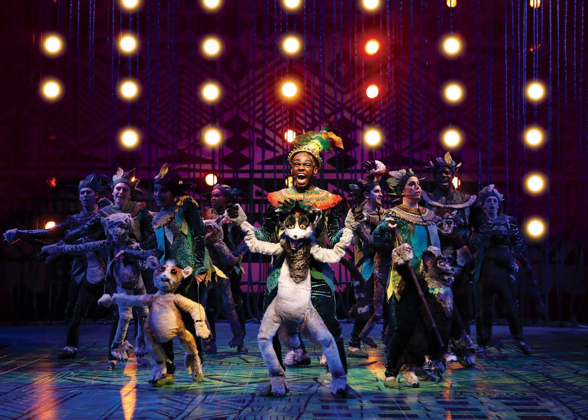 """Aaron Holland (center) plays King Julien in """"Madagascar – A Musical Adventure,"""" at the Chicago Shakespeare Theater. 
