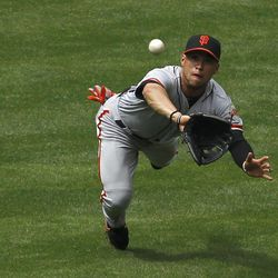 San Francisco Giants' Gregor Blanco makes a diving catch on a line drive by Arizona Diamondbacks' Ryan Roberts during the fourth inning in an MLB baseball game Sunday, April 8, 2012, in Phoenix.