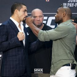 Robert Whittaker and Yoel Romero square off at UFC 225 media day.