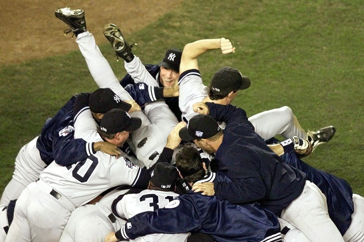 Members of the New York Yankees celebrate after wi