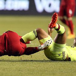 United States' Jordan Morris (18) and Venezuela's Aristoteles Romero (16) trip over each other during a soccer game at Rio Tinto Stadium in Sandy on Saturday, June 3, 2017. They tied 1-1.