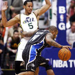 Utah Jazz guard Devin Harris (5) tries to defend Orlando's #14 Jameer Nelson as the Utah Jazz and the Orlando Magic play Saturday, April 21, 2012 in Energy Solutions arena.