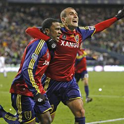 Real's Robbie Findley (left) and Yura Movsisyan celebrate after Findley scored in the second half to force overtime.