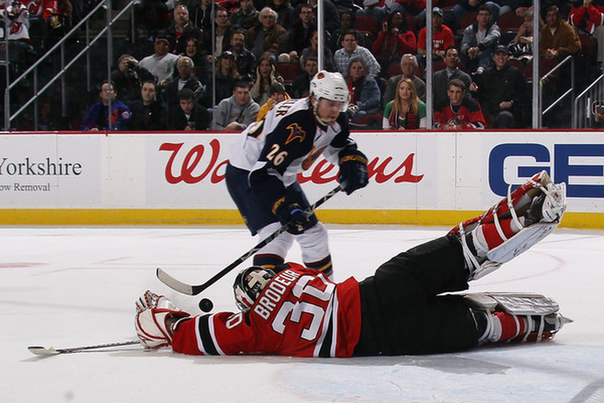 One of Martin Brodeur's many diving saves to stop a dangerous chance by Atlanta.  This one came with a little over a minute left to play, Blake Wheeler was denied by the legendary goaltender. (Photo by Bruce Bennett/Getty Images)