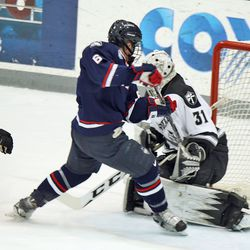 UConn's Johnny Austin (6) is denied by Providence's Hayden Hawkey (31).