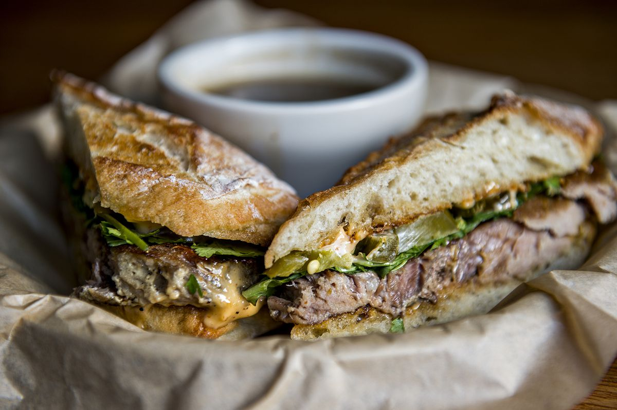 The Saigon with garlic pork, cilantro, basil and jalapenos on a ciabatta roll with spicy mayo and a side of pho broth.