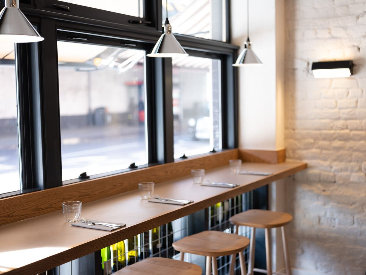 The counter at Two Lights by Chase Lovecky — facing out onto Kingsland Road in Shoreditch