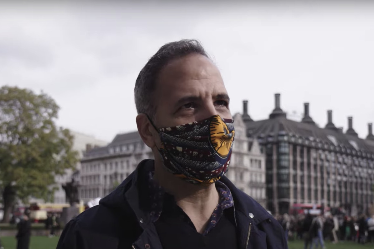 Yotam Ottolenghi standing in Parliament Square, wearing a mask