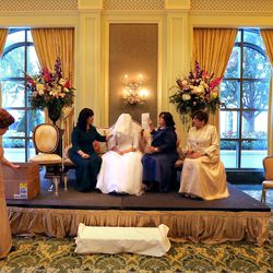 Jettie Schochet, Sharonne Zippel, Chaya Zippel, Rosa Cohen and Suzanne Cohen rest after the badeken, or veiling ceremony, before Chaya marries Rabbi Mendy Cohen in a traditional Chabad Lubavitch Jewish wedding at the Grand America Hotel in Salt Lake City on Monday, Sept. 12, 2016. Schochet is the bride's grandmother. Sharonne Zippel is the bride's mother. Rosa Cohen is the groom's mother. Suzanne Choen is the groom's grandmother.