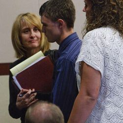 Dallin Todd Morgan, 18, pleaded no contest Thursday, Aug. 30, 2012, to criminal mischief in a plot to bomb an assembly at Roy High School earlier this year. He was ordered to serve 105 days in jail and up to 18 months probation. He leaves the courtroom flanked by his attorney Brenda Beaton, left, and his mother, right.