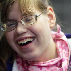 Maura Lloyd laughs while at Jordan Valley School in Midvale Tuesday, Feb. 19, 2013. Lloyd does not speak and has severe visual and hearing impairments.