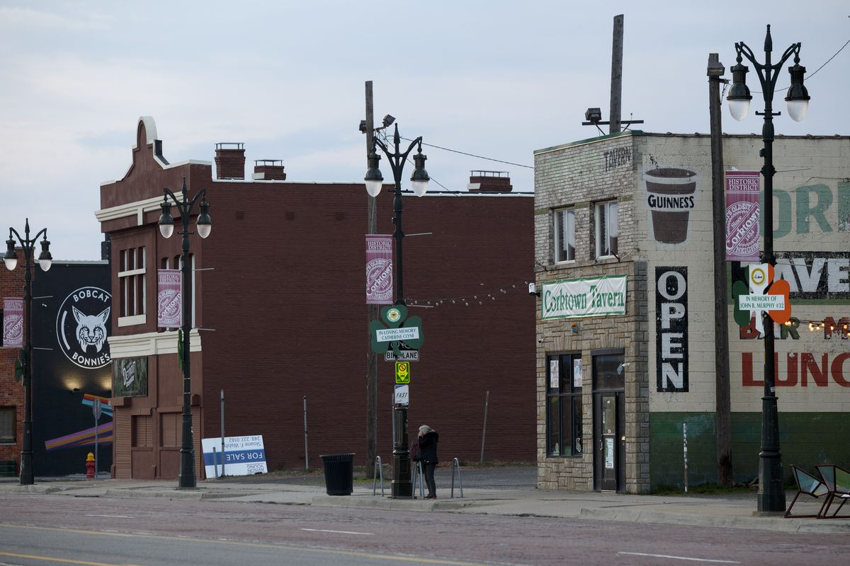 A women waits for the bus in the historic Corktown neighborhood on April 8, 2020 in Detroit, Michigan. In an effort to slow the spread of the coronavirus (COVID-19), Detroit Department of Transportation buses will begin distributing surgical masks to riders. Over 20,000 coronavirus cases have been confirmed in the state.