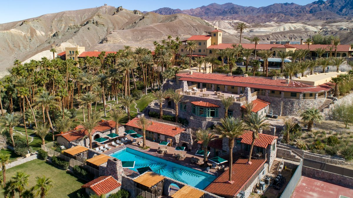 An overhead look at a desert resort property with shimmering pool.