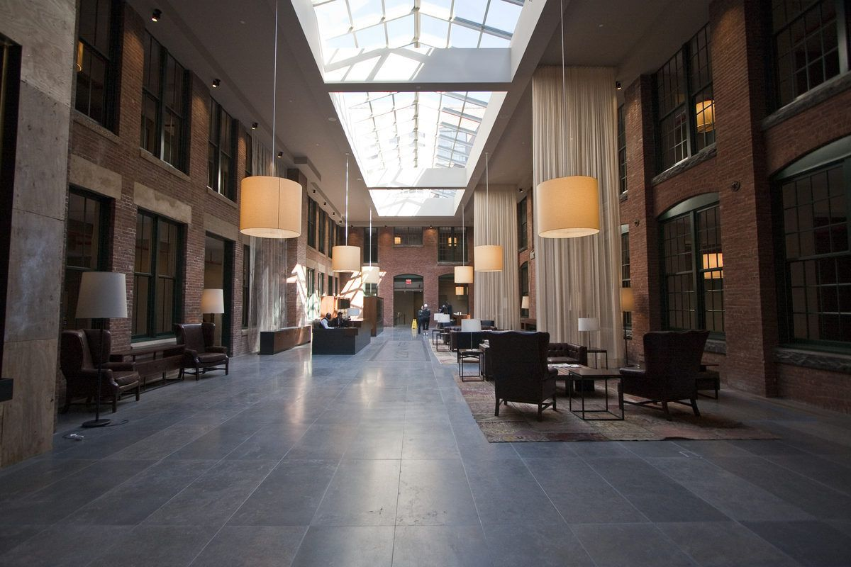 The long view of the building's lobby looking toward the Water Street side. The waterfall is on the left in the foreground.