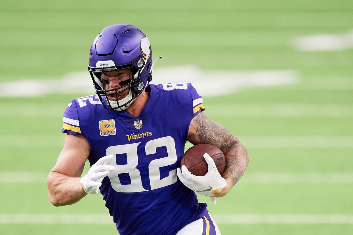 Kyle Rudolph #82 of the Minnesota Vikings carries the ball against the Atlanta Falcons during the game at U.S. Bank Stadium on October 18, 2020 in Minneapolis, Minnesota.