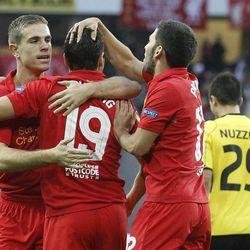 Liverpool's Jordan Henderson, Stewart Downing and Daniel Pacheco, from left,  celebrate after scoring the opening goal during the UEFA Europa League Group A soccer match between BSC Young Boys Bern and Liverpool FC at the Stade de Suisse in Bern, Switzerland, Thursday, September 20, 2012.