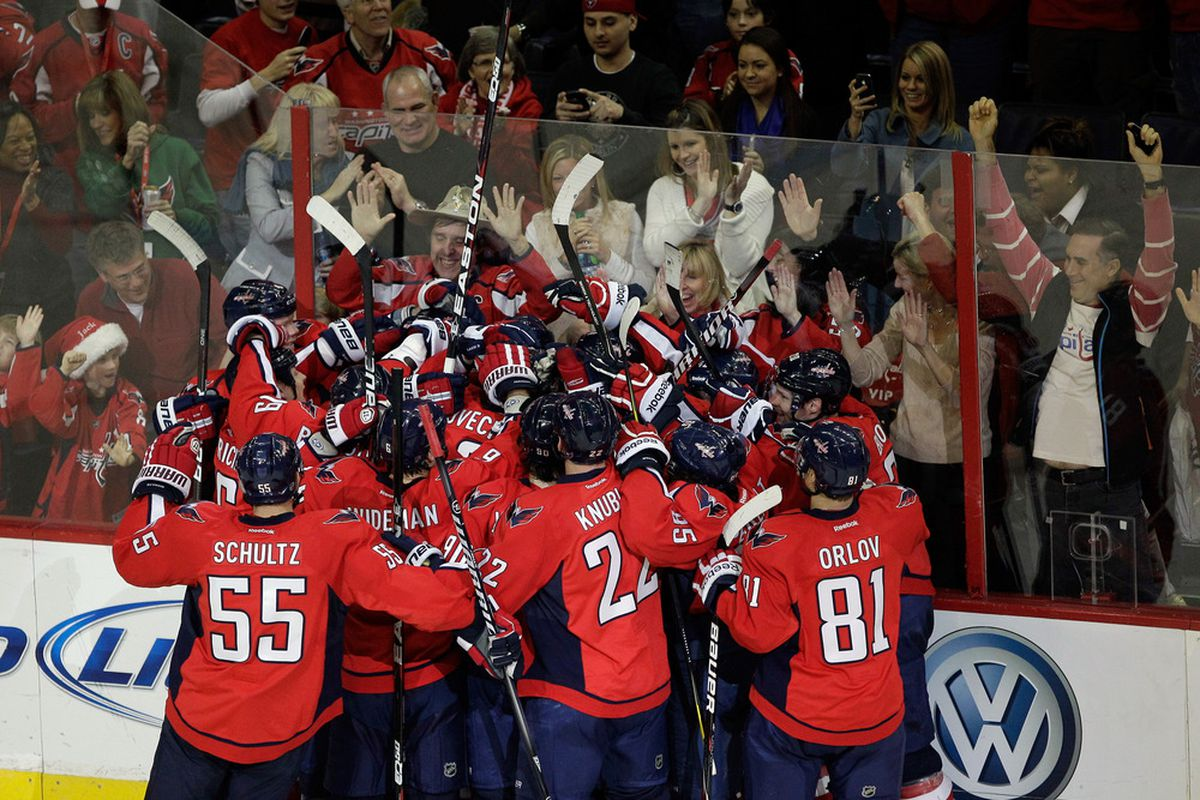WASHINGTON, DC - DECEMBER 03: Members of the Washington Capitals celebrate their 3-2 overtime win against the Ottawa Senators at Verizon Center on December 3, 2011 in Washington, DC.  (Photo by Rob Carr/Getty Images)