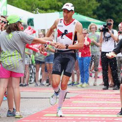 Timo Bracht of Germany runs in the second transition area during the Challenge Roth on July 20, 2014 in Roth, Germany. (Photo by Alex Grimm/Getty Images)