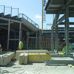 1:51 p.m. Workers organizing sections for the right-field video board structure on Sheffield -