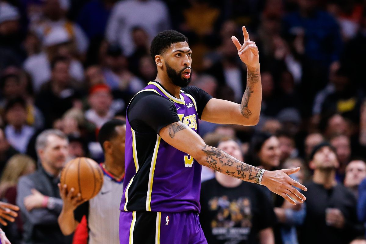 Los Angeles Lakers forward Anthony Davis reacts after a play in overtime against the Denver Nuggets at the Pepsi Center.