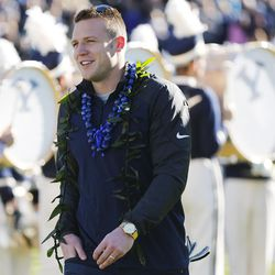 Brigham Young Cougars quarterback Taysom Hill (4) and other seniors are honored prior to the game against Fresno in Provo Saturday, Nov. 21, 2015. BYU won 52-10.