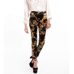 """<b>Tobi</b> Fleur de Noir Pants in black/gold, <a href=""""http://www.tobi.com/product/48059-tobi-fleur-de-noir-pants?color_id=63346"""">$44</a>"""