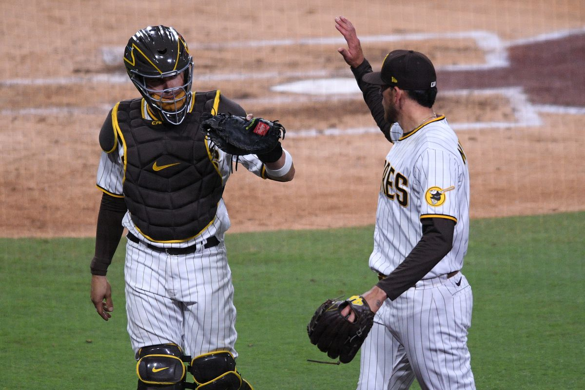 San Diego Padres catcher Victor Caratini and starting pitcher Joe Musgrove celebrate after recording the last out of the sixth inning against the Milwaukee Brewers at Petco Park.