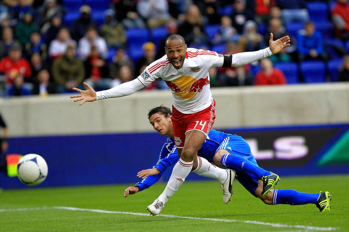 Thierry Henry of the New York Red Bulls is challenged by Zarek Valentin of the Montreal Impact on Saturday.
