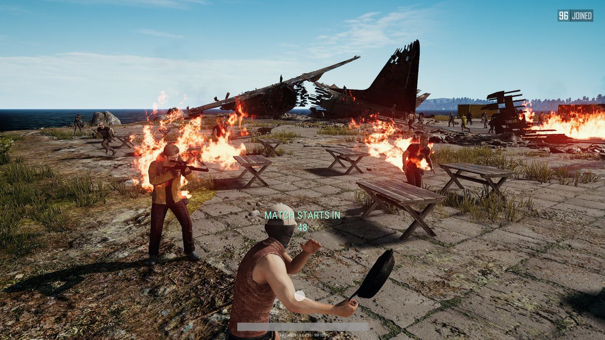 PlayerUnknown's Battlegrounds - picnic tables on fire on the island