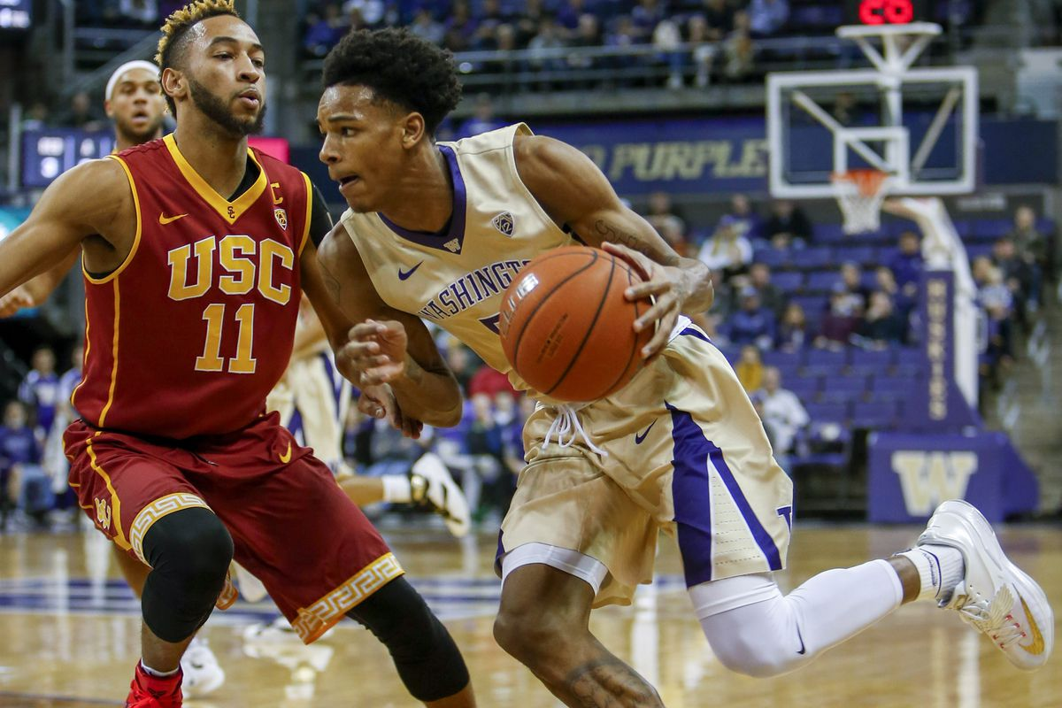 """UW guard Dejounte """"Baby Boy"""" Murray drives against USC guard Jordan McLaughlin in the 1st half of their game on Jan 3rd."""