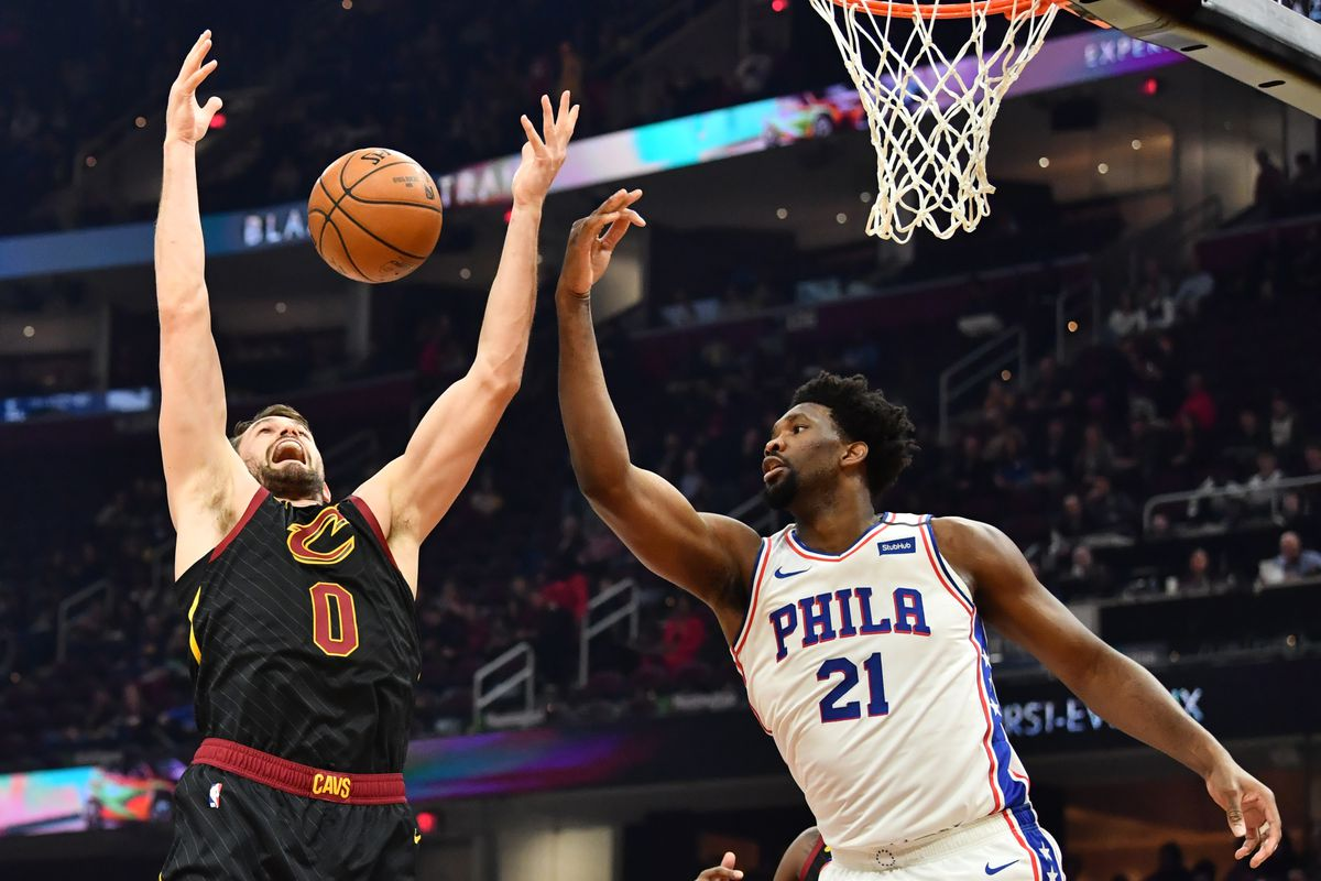 Cleveland Cavaliers forward Kevin Love goes for a rebound against Philadelphia 76ers center Joel Embiid during the first half at Rocket Mortgage FieldHouse.