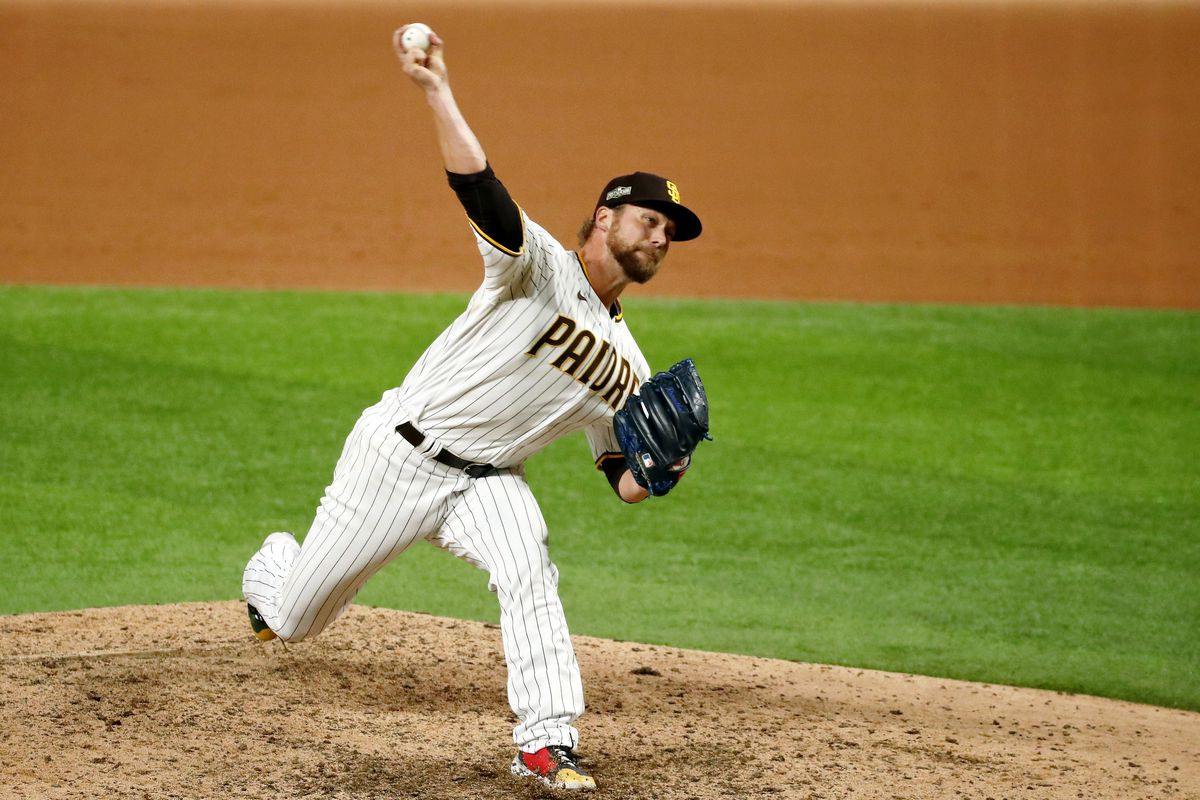 San Diego Padres relief pitcher Trevor Rosenthal (47), the eleventh pitcher for the team in the game, pitches against the Los Angeles Dodgers during the ninth inning during game three of the 2020 NLDS at Globe Life Field.