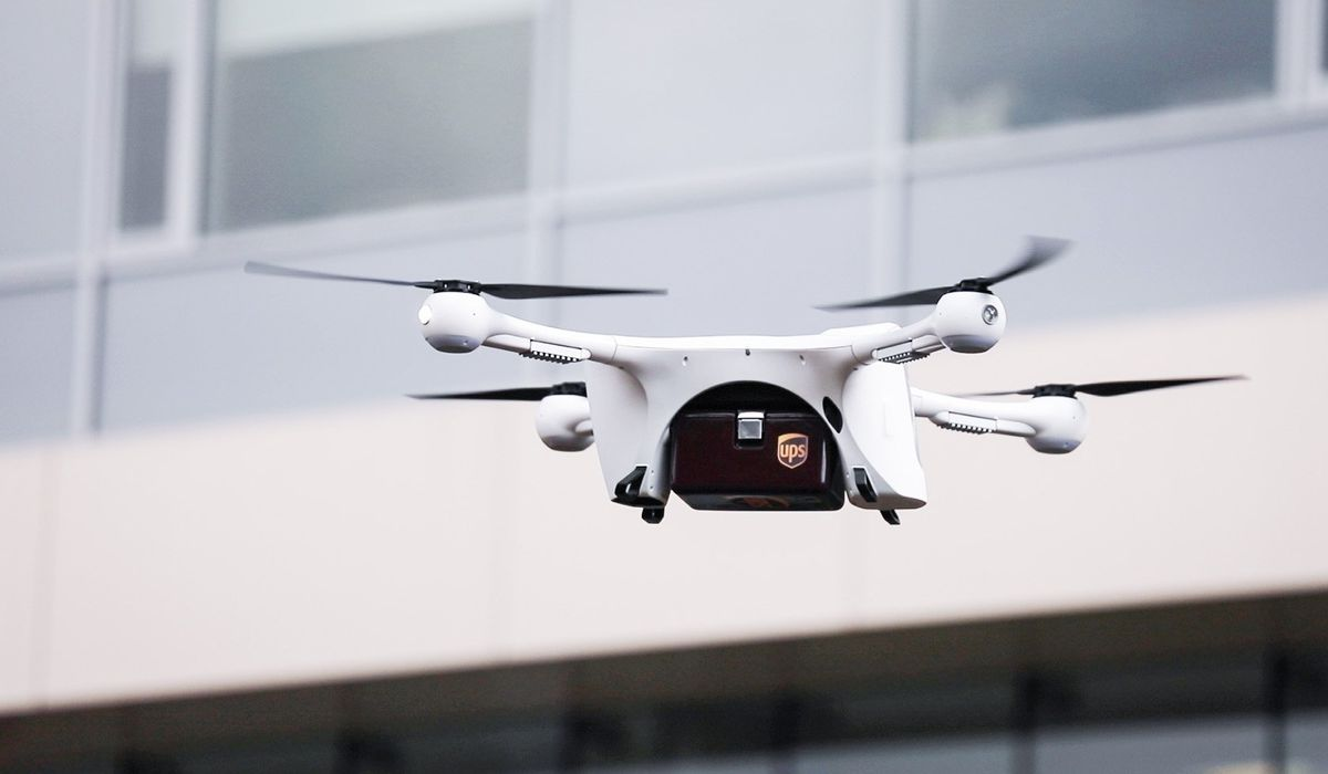 A Matternet M2 drone gets ready to land with a UPS carriage box attached at WakeMed's main hospital campusin Raleigh, North Carolina, on Tuesday, March 26, 2019. The UPS carriage, delivered by drone, will hold things like blood samples and other items to be delivered to laboratories on WakeMed's campus and help them reach their destinations in three minutes, rather than up to an hour.