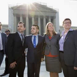 Arriving at the Supreme Court in Washington, Wednesday, June 26, 2013, on a final day for decisions in two gay marriage cases are plaintiffs in the California Proposition 8 case. From left are, Adam Umhoefer, executive director of the American Foundation for Equal Rights, plaintiffs Paul Katami, his partner Jeff Zarrillo, Sandy Stier and her partner Kris Perry, and Chad Griffin, president of the Human Rights Campaign