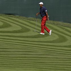 USA's Tiger Woods looks over the 12th hole during a practice round at the Ryder Cup PGA golf tournament Wednesday, Sept. 26, 2012, at the Medinah Country Club in Medinah, Ill.